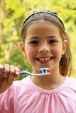 Happy, young girl with brush teeth. Happy, young girl shows us how important is to brush teeth Royalty Free Stock Photography