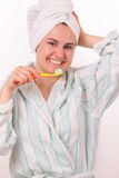Happy young girl brushes her teeth Royalty Free Stock Images
