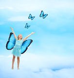 Happy Young Girl with Butterflies Stock Photos