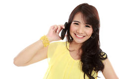 Happy young girl calling by phone. Closed up of young girl talking at the handphone Royalty Free Stock Photo