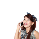 Happy young girl calling by phone Royalty Free Stock Photography
