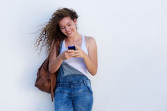 Happy young girl on cellphone texting. Portrait of happy young girl on cellphone texting Royalty Free Stock Photos