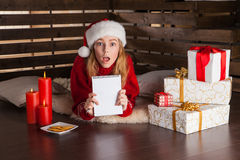 Happy young girl with Christmas presents Royalty Free Stock Photography
