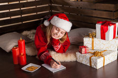 Happy young girl with Christmas presents Stock Photos