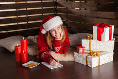 Happy young girl with Christmas presents Stock Image