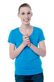 Happy young girl with clasped hands Royalty Free Stock Photos