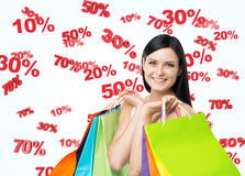 A happy young girl with the colourful shopping bags from the fancy shops. Stock Images