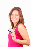 Happy young girl with credit card Royalty Free Stock Images
