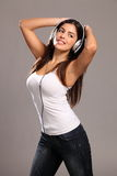 Happy young girl dancing dancing to music Royalty Free Stock Photo