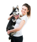 Happy young girl and dog Husky Stock Photo