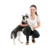 Happy young girl and dog Husky Royalty Free Stock Photos