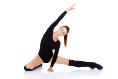 Happy young girl doing stretching Stock Images