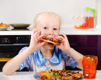Happy young girl eating pizza Royalty Free Stock Photography