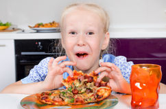 Happy young girl eating pizza Royalty Free Stock Photos