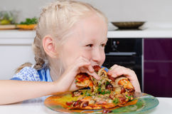 Happy young girl eating pizza Royalty Free Stock Images