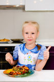 Happy young girl eating pizza Royalty Free Stock Photo