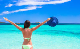Happy young girl enjoy tropical beach vacation Stock Photography