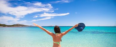 Happy young girl enjoy tropical beach vacation Stock Image