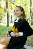 Happy young girl enjoying autumn in the park. Happy young girl enjoying beautiful autumn in the park Royalty Free Stock Image