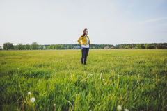 Happy young girl enjoying the beauty of sunny spring day Stock Photography