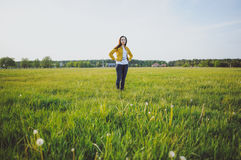 Happy young girl enjoying the beauty of sunny spring day Stock Images