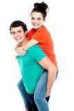 Happy young girl enjoying piggyback ride Royalty Free Stock Photos