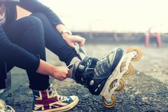 Happy young girl enjoying roller skating  Stock Images