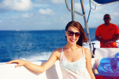 Happy young girl enjoys summer vacation in ocean cruise on powerboat Royalty Free Stock Photos