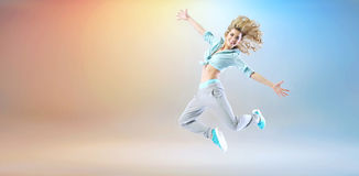 Happy young girl exercising and dancing Stock Photos