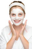 Happy young girl face mask smiling cosmetics. Cleaning cream Royalty Free Stock Image