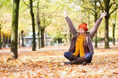 Happy young girl on a fall day Stock Images