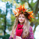 Happy young girl on a fall day Royalty Free Stock Photography