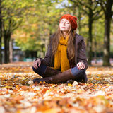 Happy young girl on a fall day Stock Photo