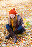 Happy young girl on a fall day Stock Image