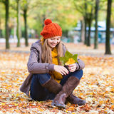 Happy young girl on a fall day Stock Photography