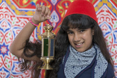 Happy Young Girl with Fez and Lantern Celebrating Ramadan Royalty Free Stock Photography