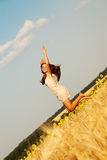Happy young girl in field Royalty Free Stock Image