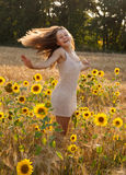 Happy young girl in field Stock Photography