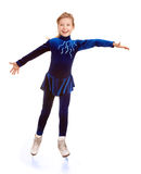 Happy young girl figure skating. Stock Image