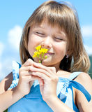 Happy young girl with a flower in his hand Stock Image