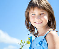 Happy young girl with a flower in his hand Royalty Free Stock Image