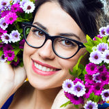 Happy young girl with flowers Stock Photo