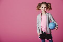 Happy young girl with football Stock Images