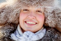 Happy young girl in a fur hat Stock Photo