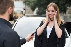 Happy girl gets car keys Stock Image