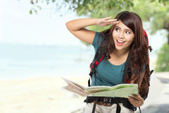 Happy young girl going on vacation with backpack and map Royalty Free Stock Photos