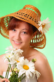 Happy young girl in the hat with chamomile flowers Royalty Free Stock Image