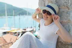 Happy young girl in hat and sunglasses relax and enjoying travelin royalty free stock photos