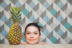 Happy young girl head with fresh sweet pineapple Royalty Free Stock Photos