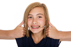 Happy young girl with headgear. A cute young girl wearing orthodontic headgear Royalty Free Stock Photo